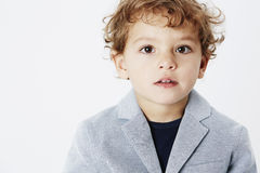 Young boy on grey background Royalty Free Stock Image