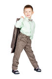 Young boy in grey suit and bow tie holding his jacket and lookin Royalty Free Stock Photography