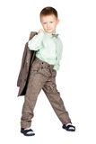 Young boy in grey suit and bow tie holding his jacket and lookin Royalty Free Stock Photos