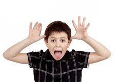 Young boy grimacing Royalty Free Stock Image