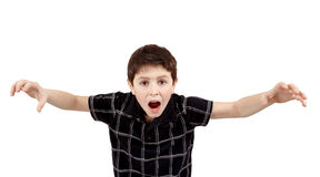 Young boy grimacing Stock Images