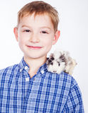 Young boy with guinea pig Stock Photography