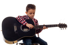 Young boy with guitar Royalty Free Stock Photos