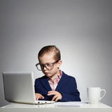 Young boy hacking into the system.little hacker Royalty Free Stock Image
