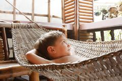 Young boy in hammock Stock Images