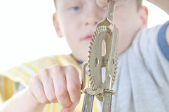 Young boy with hand mixer Stock Images