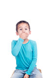 Young boy with hand over mouth Stock Photo