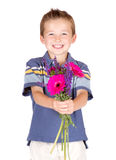 Young boy handing flowers Royalty Free Stock Photography