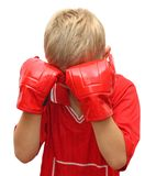 Young boy with hands in red gloves on his face. Stock Photography