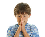 Young boy with hands together Royalty Free Stock Photo