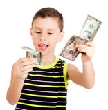 Young boy happily playing with dollars Stock Image