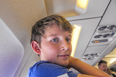 Young boy is happy arriving with the aircraft Stock Photography