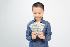 Young boy with happy and smile with bank note Royalty Free Stock Image