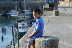 Young boy in a harbor Royalty Free Stock Images