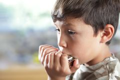 Young boy with harmonica Stock Photo