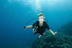 Young boy has fun ona scuba dive Stock Photo