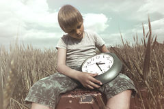 Young boy has the power to control the time Stock Image