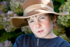Young boy with hat like farmer Stock Photography