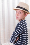 Young boy with hat looking angry into the camera Royalty Free Stock Photos