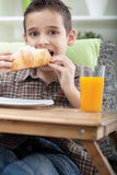 Young boy having breakfast Stock Photo