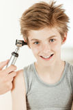 Young boy having ear examination. Portrait of smiling young boy having his ear test by pediatric otolaryngology doctor Royalty Free Stock Image