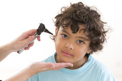 Young boy having ear examination during a visit Stock Photography