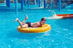 Young boy having fun in aquapark Stock Photos