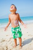 Young boy having fun at the beach Stock Image