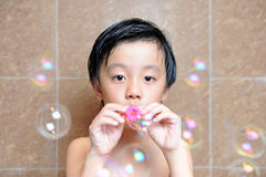 Young boy having fun with bubbles Stock Image