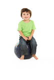 Young Boy Having Fun On Inflatable Hopper Royalty Free Stock Photography