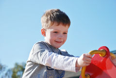 Young boy having fun at the play park Royalty Free Stock Image