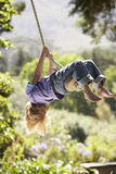 Young Boy Having Fun On Rope Swing Stock Image