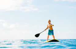 Young Boy Having Fun Stand Up Paddling. In the Ocean Royalty Free Stock Photo