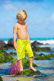 Young boy having fun on tropcial beach Stock Photo