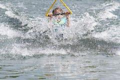 Young boy having fun in water Stock Image