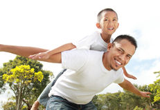 Young boy having piggyback ride Stock Photo