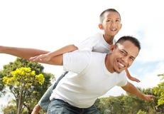 Young boy having piggyback ride Stock Photo