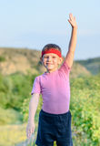 Young Boy with Headband Raising his One Arm Stock Photography