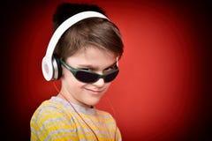 Young boy with headphones enjoying music Stock Photos