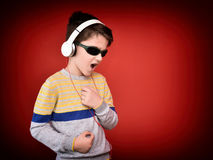 Young boy with headphones enjoying music Royalty Free Stock Images