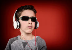 Young boy with headphones enjoying music Stock Photo