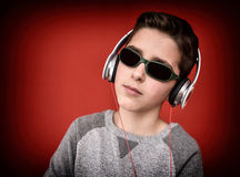 Young boy with headphones enjoying music Royalty Free Stock Photo