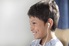 Young boy with headphones watching computer Royalty Free Stock Images