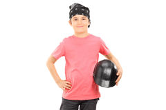 Young boy with headscarf holding a bikers helmet. Isolated on white background Stock Photos