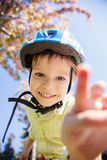 Young boy in helmet looking at camera Stock Photo