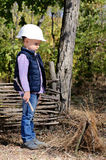 Young Boy with Helmet Playing at the Woods Stock Photos