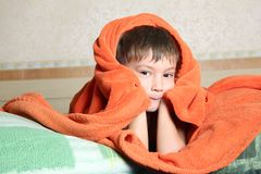 Young boy hiding under blanket Stock Image