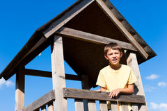 Young boy in a high seat Stock Images