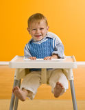 Young boy in highchair Royalty Free Stock Images