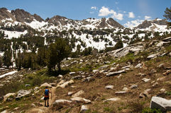 Young boy hiking alone in the mountains Stock Image